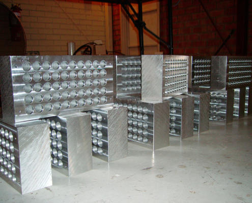 CNC machined aluminium blocks. CNC machining by Routers Australia