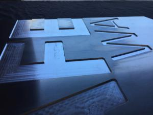 CNC Routing signs: Aluminium TAFE WA sign with 3mm deep recessed letters to be paint-filled.