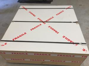 CNC Routing signs: Final packaging in wooden crate for long distance travel.