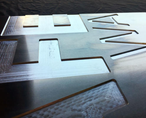 CNC-engraved Aluminium sign for TAFE WA. 3 mm-deep recessed letters. Sign engraving by Routers Australia, Perth WA